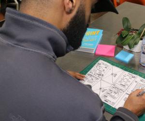 Sketching solutions at a Pentalog Design Sprint Workshop